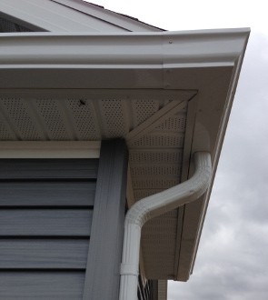 Gutter and Downspout on Corner of House